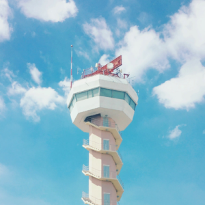 The top of a flight tower against a blue sky