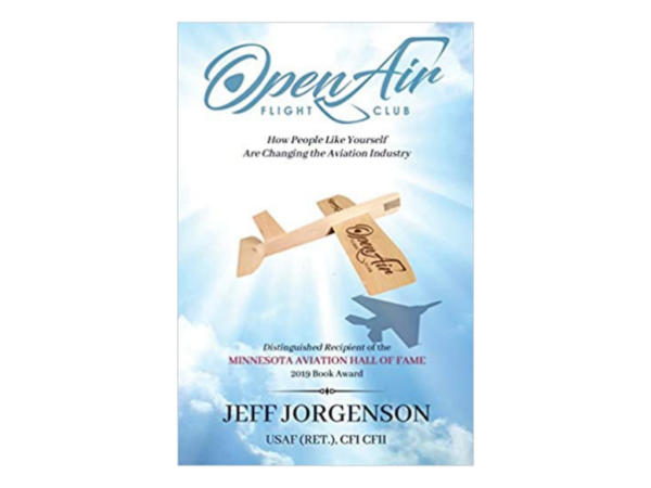 Cover of the book Open Air Flight Club by Jeff Jorgenson, The story of how people like yourself are changing the aviation industry. Cover features a wooden airplane flying through blue sky.