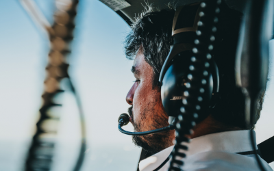 a pilot sits in the cockpit of a commercial passenger plane